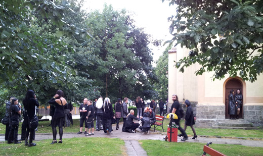 Gathering outside the former evangelical church/venue
